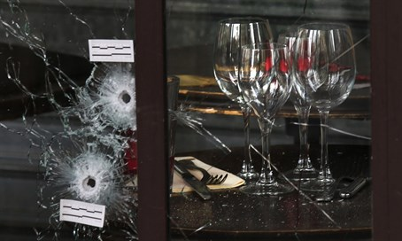 Bullet holes in the window of a restaurant targeted in Paris attack