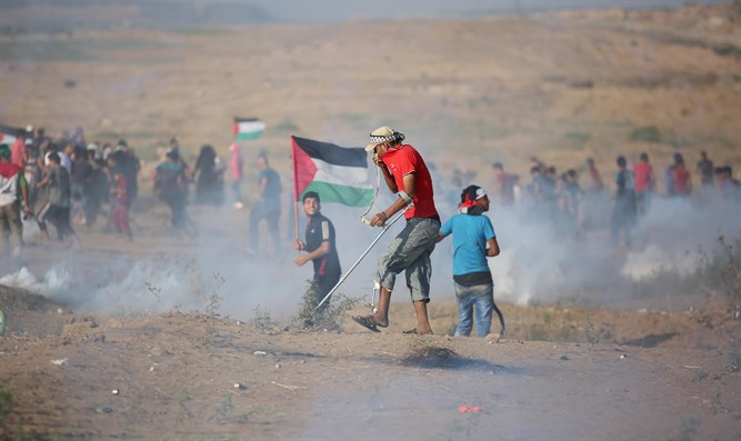 Protesters clash with Israeli forces at the Israel-Gaza border
